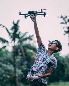 Man Holding Quadcopter Drone With Controller