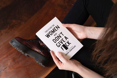 Woman Holding White Book