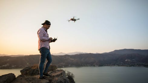 Man Flying A Drone