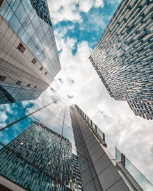 Low Angle Photography Of Glass Buildings