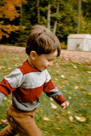 Photo Of Toddler Running On Grass