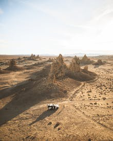 Aerial Photo Of Vehicle Near Rock Formations