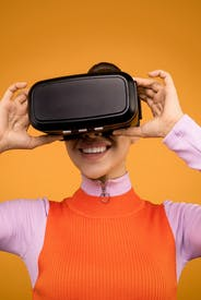 Woman In Long Sleeve Shirt Putting On Her Vr Headset