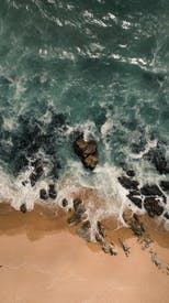Stormy Sea Waves And Sandy Beach