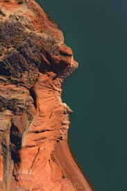 Rough Brown Rocky Formation On Gray Background