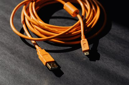 Orange Usb Charger Cable On Black Surface