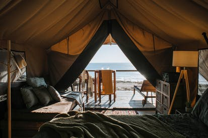 Cozy Tent With Bed And Terrace On Beach