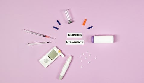 Diabetes Prevention Text On Pink Background With Medical Supplies